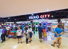 Amusement arcade in MBK shopping center, Bangkok City. BANGKOK - MARCH 16, 2016: Children and adults play on game machines at the Hero city at the MBK Center, a Royalty Free Stock Photography