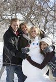 Amusement de jour de neige avec le bonhomme de neige Images stock