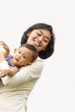 Amusement de mère de fonctionnement avec l'enfant images stock