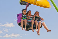 Amusement Fun. OCALA, FLORIDA, UNITED STATES - SEPTEMBER 2010: AMUSEMENT RIDE. Three friends enjoying an amusement ride at a carnival in Ocala, Florida in royalty free stock photos