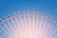 Amusement funfair giant ferris wheel. With clear blue sky background Royalty Free Stock Photo