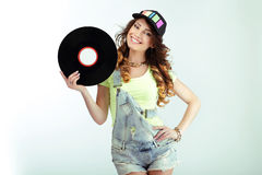 Amusement. Funny Woman holding Vinyl Record and Smiling Royalty Free Stock Images
