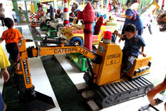 Amusement. Kids enjoyed the rides at an amusement park in the city of Solo, Central Java, Indonesia Royalty Free Stock Images