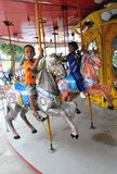 Amusement. Kids enjoyed the rides at an amusement park in the city of Solo, Central Java, Indonesia Stock Image