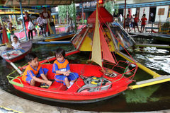 Amusement. Kids enjoyed the rides at an amusement park in the city of Solo, Central Java, Indonesia Stock Photos
