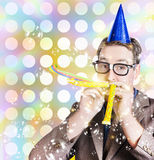 Amusement man in party hat celebrating a birthday bash. Bright and vibrant photograph of a nerd man in glittering party hat celebrating a birthday bash with a Royalty Free Stock Photography