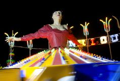 Amusement park. Ballerina at amusement park by night Royalty Free Stock Photos