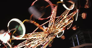 Amusement park ballerina ride with colorful lights shot at night – fun activities 4k video background stock video