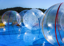 Amusement park bubbles. Empty balls in a pool at a funfair waiting for children Royalty Free Stock Photo