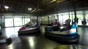 Amusement Park Bumper Cars Fun. People have fun at an amusement park midway riding on a bumper cars ride. Fun for the whole family and children stock video