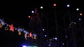 Amusement park - car trail. And colorful lights flashing stock footage