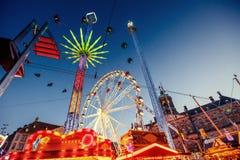 Amusement park carousel. Beautiful night lighting. A fairy tale for children Stock Photo