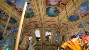 Amusement park carousel. With beautifully painted wooden animals stock video