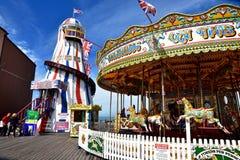 Amusement park carousel on Brighton beach pier Stock Photos