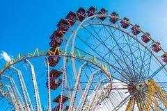 Amusement park. Carousel and Ferris wheel Stock Photos