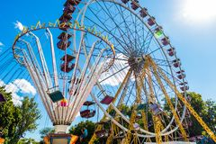 Amusement park. Carousel and Ferris wheel. Royalty Free Stock Images