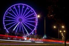 Amusement park - carousel at night stock photography