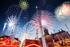 Amusement park at the center of Amsterdam at night. Beautiful starry sky, majestic fireworks on the nightlife Stock Images
