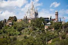 Amusement Park  and  Church at Tibidabo in Barcelona Royalty Free Stock Images