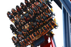 Amusement park coaster falling down rails with people royalty free stock photography