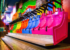 Amusement park. Colored roller coaster seats in amusement park Royalty Free Stock Image