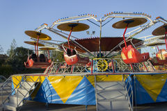 Amusement park. Colorful children's carousel coaster Student royalty free stock image