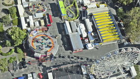 Amusement park with ferris wheel from above Stock Images