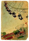 Amusement park, a Ferris wheel. Old postcard Royalty Free Stock Photo