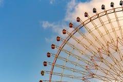 Amusement park giant wheel against blue sky royalty free stock image