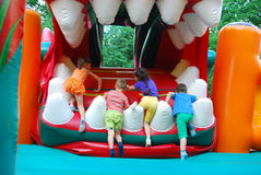 In the amusement park, inflatable slide for kids climbs. Royalty Free Stock Image