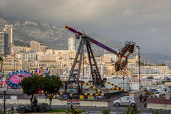 Amusement park infront of densely populated district of Monaco. Monaco, Monte Carlo - November 4, 2016: Amusement park infront of densely populated district of Stock Photography
