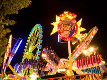 Amusement park at night. Night shot, motion blur. Amusement park series Royalty Free Stock Photo