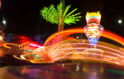 Amusement park at night. Colourful Amusement park at night Royalty Free Stock Images