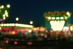 AMUSEMENT PARK at night in bokeh Royalty Free Stock Image