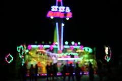 AMUSEMENT PARK at night in bokeh Stock Image