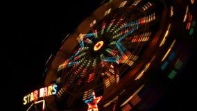 Amusement park at night stock video