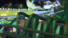 Amusement park at night - roller coaster stock video footage