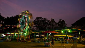 Amusement park at night. Time Lapse. Amusement park at night, ferris wheel in motion, HD stock footage