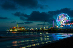 Amusement park on the pier in Santa Monica at night, Los Angeles, California, USA Stock Images