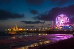 Amusement park on the pier in Santa Monica at night, Los Angeles, California, USA Royalty Free Stock Image