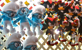 Amusement Park Prizes. Stuffed animal figures hang suspended as prizes from a lattice structure above a game in an amusement park Stock Images