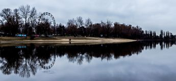 Amusement park in reflection River. Dark autumn Stock Photos