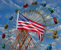 Amusement park ride with American flag Stock Images