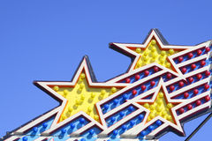 Amusement Park Ride Lights. Against Clear Blue Sky Royalty Free Stock Photography