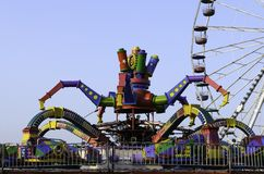 Amusement park. Rides with blue sky background Royalty Free Stock Image