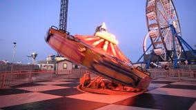 Amusement park rides illuminated at night stock footage
