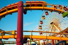 Amusement park rides on a pier Stock Images