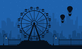 Amusement park scenery at night silhouettes Stock Photography