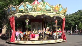 Amusement park. Spinning carousel in the amusement park stock video