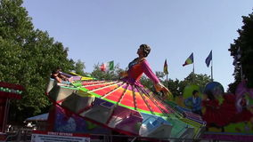 Amusement park. Spinning lady carousel in the amusement park stock footage